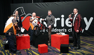 """Bif Ridgway and BIKE WORLD are presented the """"Sunshine Award"""" by Variety The Children's Charity"""