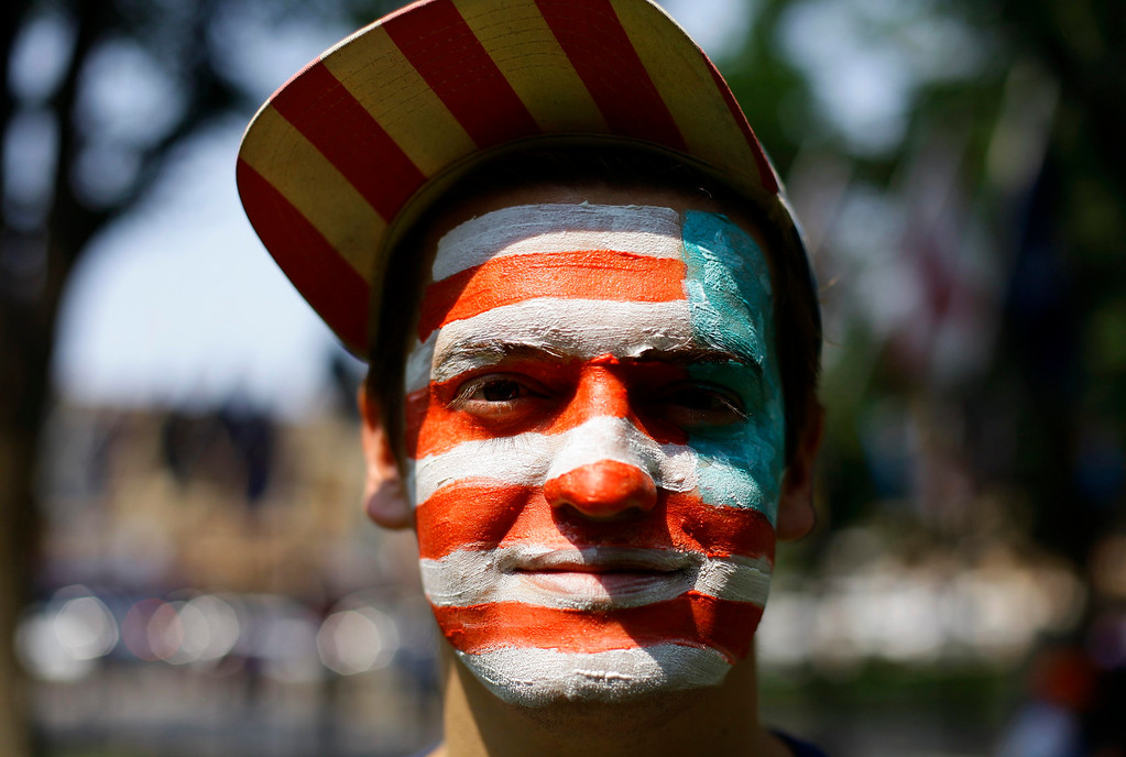 . A man with the American flag painted on his face poses for a portrait as he celebrates the Fourth of July Independence Day celebrations in Prescott, Arizona July 4, 2013. REUTERS/Joshua Lott