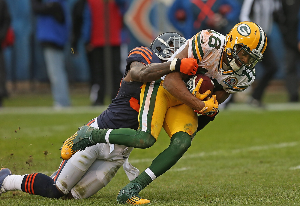 . Randall Cobb #18 of the Green Bay Packers is tackled by D.J. Moore #30 of the Chicago Bears after catching a pass for a first down at Soldier Field on December 16, 2012 in Chicago, Illinois. (Photo by Jonathan Daniel/Getty Images)