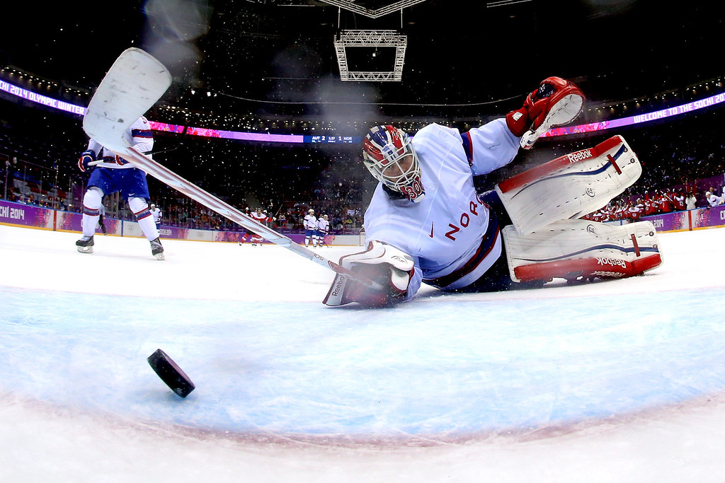 . Lars Haugen #30 of Norway gives up a goal to Michael Rene Grabner #40 of Austria in the third period during the Men\'s Ice Hockey Preliminary Round Group B game on day nine of the Sochi 2014 Winter Olympics at Bolshoy Ice Dome on February 16, 2014 in Sochi, Russia.  (Photo by Bruce Bennett/Getty Images)