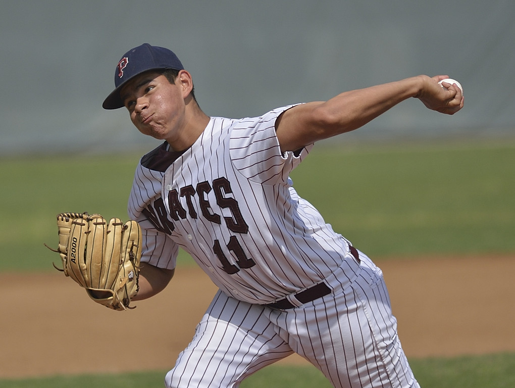 . PARAMOUNT, CALIF. USA -- Paramount\'s Ulices Moreno (11) delivers pitch during their CIF-SS Division III playoff loss to Westminster in Paramount, Calif., on Thursday, May 16, 2013. Westminster defeated Paramount, 3 to 0.  Photo by Jeff Gritchen / Los Angeles Newspaper Group