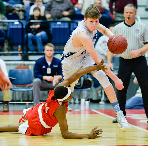 Oceanside's Cooper Wirkala takes off with the ball after a scuffle with Cony's Amahde Carter for a rebound in the second half of the Class A North Semifinal Wednesday at the Augusta Civic Center.