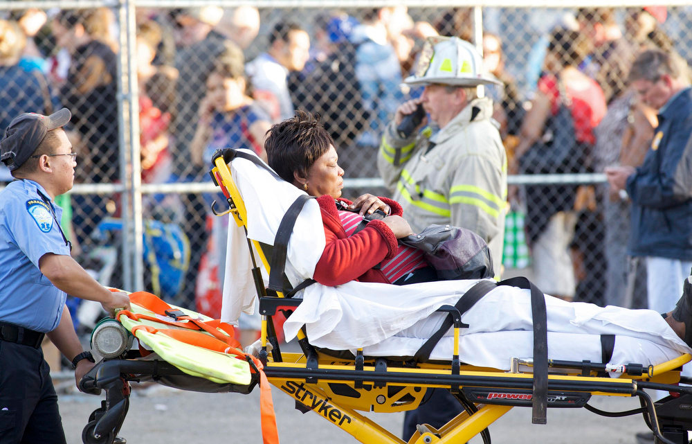 . A woman is transported to the hospital after two commuter trains collided in Bridgeport, Connecticut May 17, 2013. Some 20 to 25 people were injured on Friday when two trains collided on a commuter line near Fairfield, Connecticut, but there were no reports of fatalities, police and transit authorities said on Friday. The accident occurred when an eastbound train on the Metro North Railroad derailed and collided with a westbound train near Fairfield, said Metropolitan Transit Authority spokesman Aaron Donovan. REUTERS/ Michelle McLoughlin