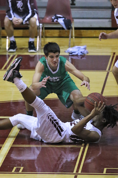 Anthony Grillo (top) from Brick battles with Jean-Louis Nickerson from Toms River South for a loose ball as Brick Township High School takes on Toms River South High School in a boys varsity basketball game held in Toms River on January 3,2019. (MARK R. SULLIVAN /THE OCEAN STAR)