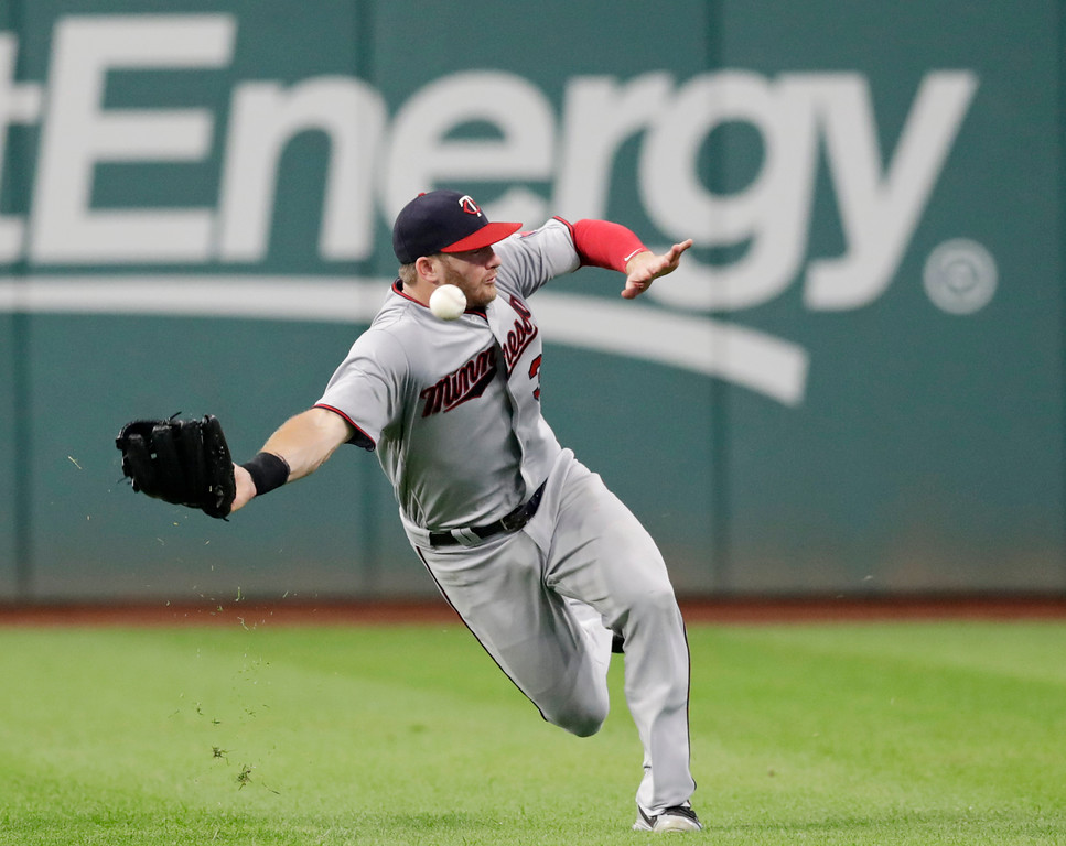 . Minnesota Twins\' Robbie Grossman lets the ball get by him in the fourth inning of a baseball game against the Cleveland Indians, Wednesday, Aug. 29, 2018, in Cleveland. Jason Kipnis was safe at second base for a double. (AP Photo/Tony Dejak)