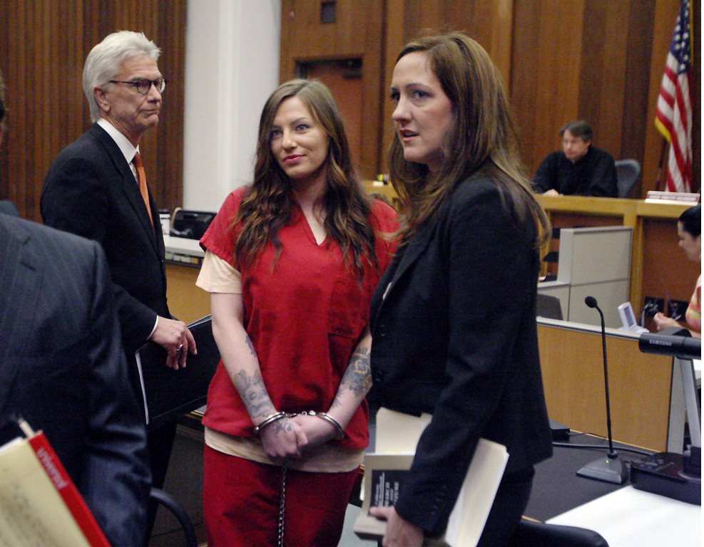 . Flanked by her attorneys, Alix Tichelman makes eye contact with her parents in the front row of court Tuesday after Tichelman changed her plea to guilty in the heroin death of former Google executive Forest Hayes and was sentenced to six years in jail.  Tichelman will probably serve only half that with time off for good behavior.   (Dan Coyro -- Santa Cruz Sentinel)
