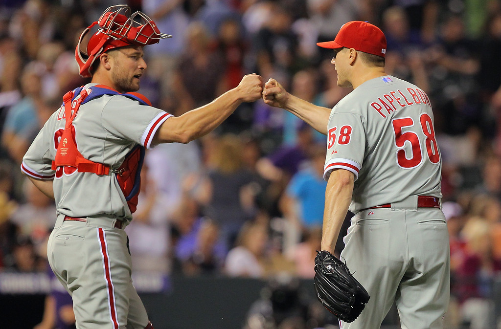 . DENVER, CO - JUNE 14:  Catcher Steven Lerud #39 and closer Jonathan Papelbon #58 of the Philadelphia Phillies celebrate their 8-7 victory over the Colorado Rockies at Coors Field on June 14, 2013 in Denver, Colorado. Papelbon earned his 13th save of the year in the game.  (Photo by Doug Pensinger/Getty Images)