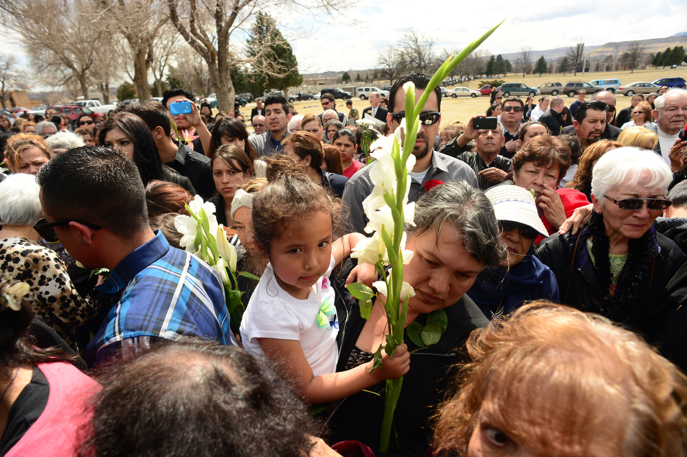 . Hundreds waited in line to put flowers on the casket of  Father Tomas Fraile at Mt. Olivet Cemetery in Wheat Ridge, Co on March 26, 2014.  His funeral was held at St. Cajetan Church at 299 South Raleigh St. in Denver, Co . Hundreds of people turned out to pay their last respects for the popular father.  (Photo By Helen H. Richardson/ The Denver Post)