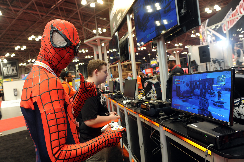. Extreme gaming enthusiasts at New York Comic Con experience some of the hottest new titles on the monitors from LG Electronics at the show\'s Free Play Zone, Friday, Oct. 11, 2013.   (Photo by Diane Bondareff/Invision for LG/AP Images)