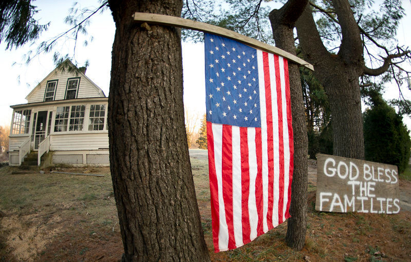 ". A sign reads ""God Bless the Families\"" outside of a home near the Sandy Hook School on December 15, 2012 in Newtown, Connecticut. The residents of an idyllic Connecticut town were reeling in horror from the massacre of 20 small children and six adults in one of the worst school shootings in US history. The heavily armed gunman shot dead 18 children inside Sandy Hook Elementary School, said Connecticut State Police spokesman Lieutenant Paul Vance. Two more died of their wounds in hospital.     DON EMMERT/AFP/Getty Images"