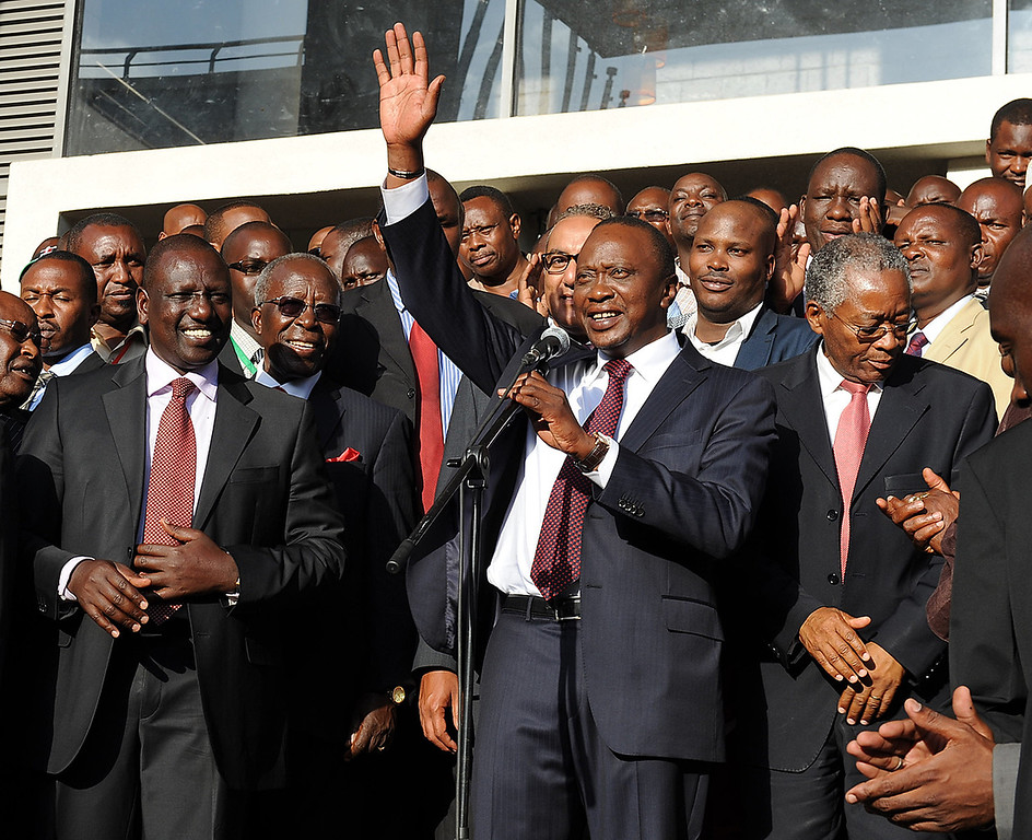 . Kenyan presidential candidate Uhuru Kenyatta (C) adresses the crowd after his victory in Kenya\'s national elections on March 9, 2013 at Catholic University in Nairobi.     AFP PHOTO / JENNIFER Huxta/AFP/Getty Images