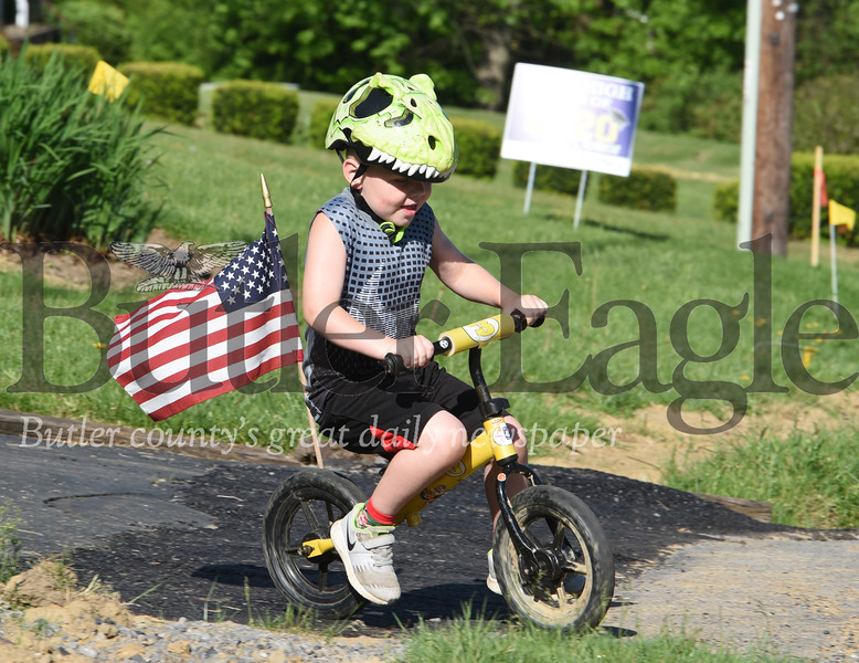 Harold Aughton/Butler Eagle: Brayden Bickford, 5, of Middlesex Twp. took a ride on his bike with his grandfather along Dwellington Dr. Monday morning, May 26, 2020.