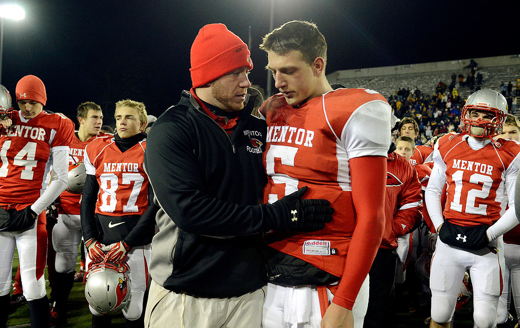 . Maribeth Joeright/MJoeright@News-Herald.com<p> Mentor\'s Conner Krizancic is consoled by one of his coaches after their 55-52 loss to Archbishop Moeller in the Division I state final game against Archbiship Moeller, Saturday, in Canton.