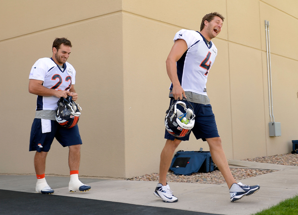 . Denver Broncos Britton Colquitt comes out of the locker room faking a laugh during training camp July 26, 2013 at Dove Valley. (Photo By John Leyba/The Denver Post)