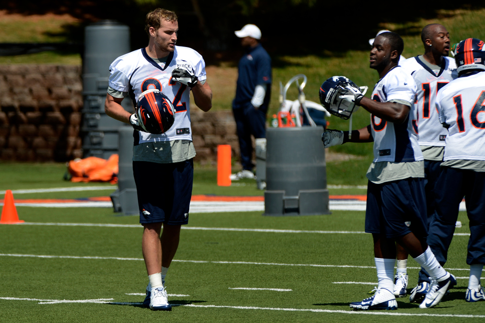 . Rookie tight end # 82 Lucas Reed and running back # 38 Montee Ball during a break at Broncos rookie minicamp at the Broncos Dove Valley facility May 10, 2013 Centennial, Colorado. (Photo By Joe Amon/The Denver Post)