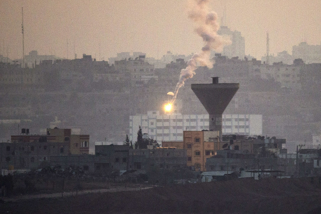 . A picture taken from the southern Israeli Gaza border shows an Israeli army flare illuminating the sky over the Gaza strip, on July 21, 2014. Israeli forces killed more than 10 Gaza militants who had infiltrated southern Israel today, the army said, later announcing it had lost four soldiers in that battle. AFP PHOTO / JACK  GUEZ/AFP/Getty Images