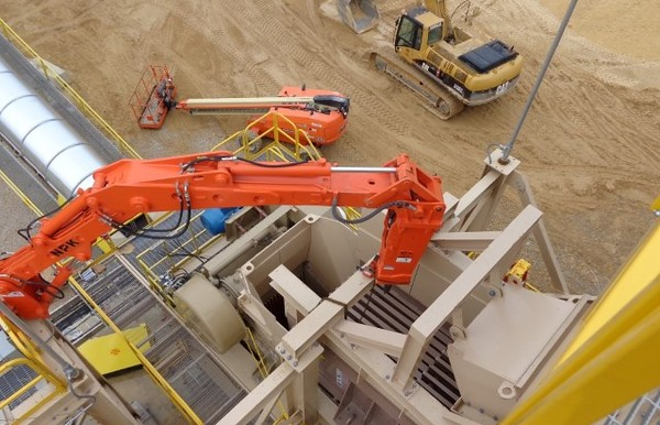 NPK B500 pedestal boom system with PH4 hydraulic hammer-breaking bridged rock in quarry (2).JPG