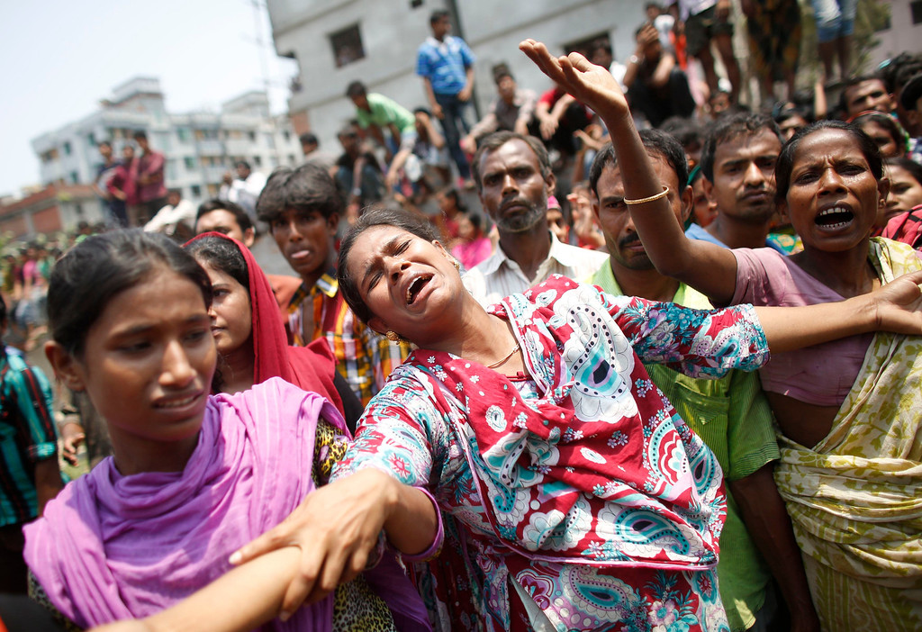 . People mourn for their relatives, who were working in the Rana Plaza building when it collapsed, in Savar, 30 km (19 miles) outside Dhaka April 24, 2013. REUTERS/Andrew Biraj