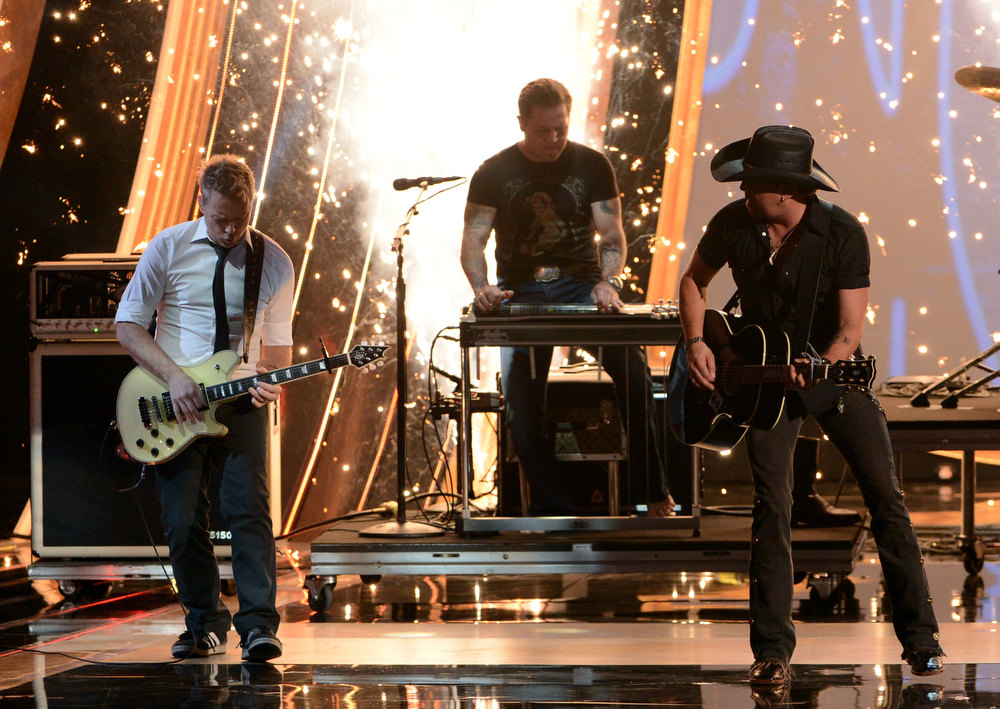 Description of . Singer Jason Aldean (R) performs onstage at the 39th Annual People's Choice Awards  at Nokia Theatre L.A. Live on January 9, 2013 in Los Angeles, California.  (Photo by Kevin Winter/Getty Images for PCA)