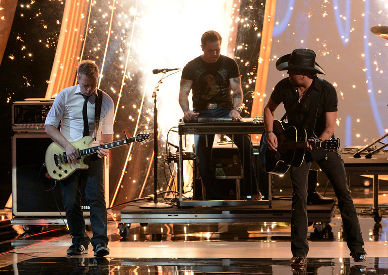 . Singer Jason Aldean (R) performs onstage at the 39th Annual People\'s Choice Awards  at Nokia Theatre L.A. Live on January 9, 2013 in Los Angeles, California.  (Photo by Kevin Winter/Getty Images for PCA)