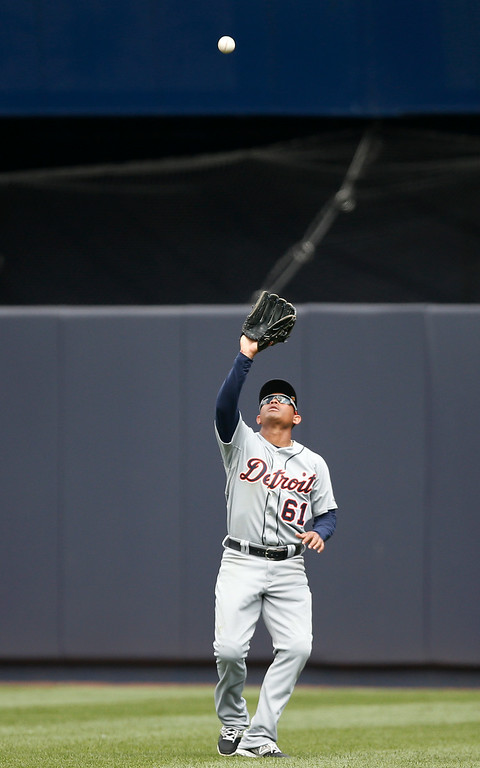 . Detroit Tigers center fielder Ezequiel Carrera (61) fields Francisco Cervelli\'s fourth-inning flyout in a baseball game against the New York Yankees at Yankee Stadium in New York, Thursday, Aug. 7, 2014.  (AP Photo/Kathy Willens)