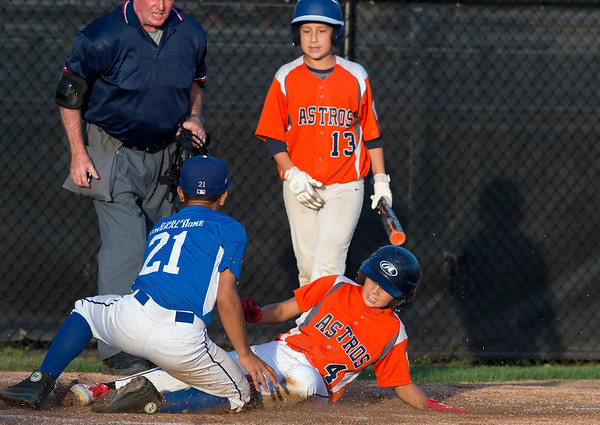 08/26/19 Wesley Bunnell | Staff The McCabe-Waters Astros defeated the Forrestville Dodgers 3-0 at Breen Field on Monday night in the city series to force a winner takes all on Wednesday. Aiden Lopez (21) is unable to tag Chase Dauphinee (4) in time.