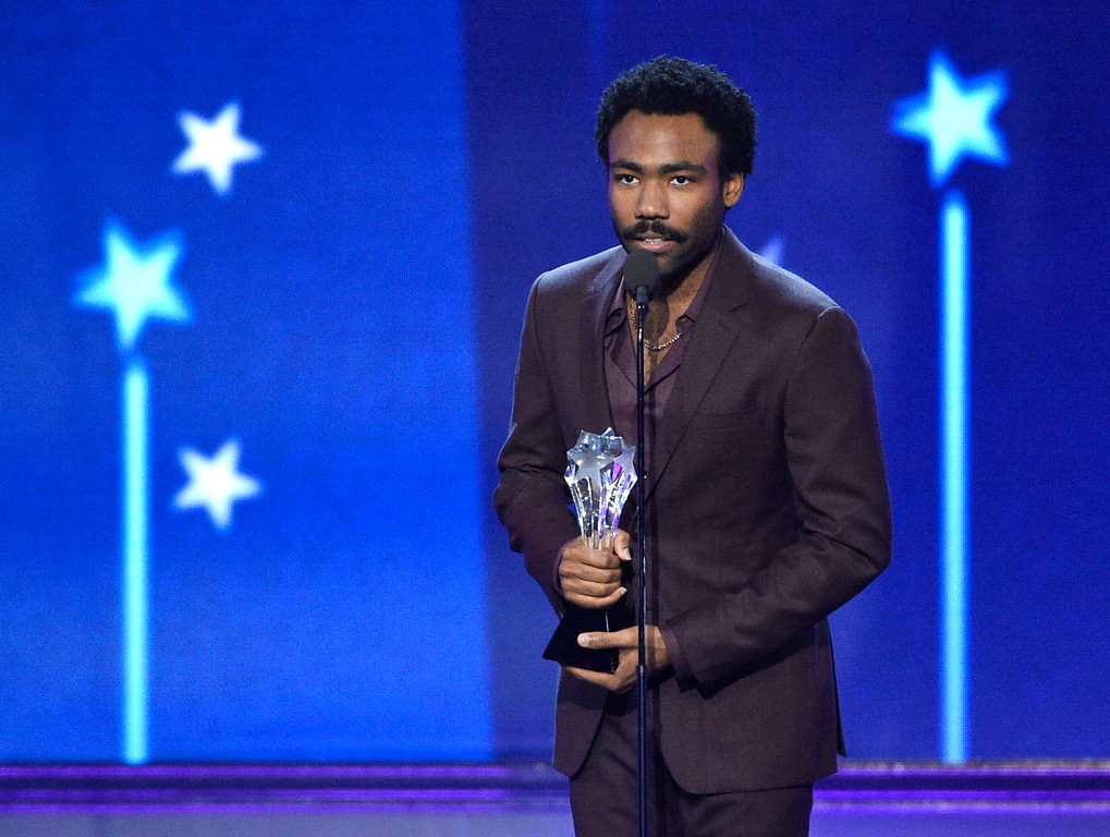 """. Donald Glover accepts the award for best actor in a comedy series for \""""Atlanta\"""" at the 22nd annual Critics\' Choice Awards at the Barker Hangar on Sunday, Dec. 11, 2016, in Santa Monica, Calif. (Photo by Chris Pizzello/Invision/AP)"""