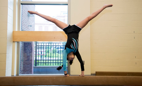 08/22/19 Wesley Bunnell | Staff The New Britain YWCA held an open house on Thursday August 22, 2019 to showcase the programs and benefits for prospective members by having them visit scavenger hunt stations each with a different theme. YWCA gymnastics team member Makaila Matos practices on the balance beam.