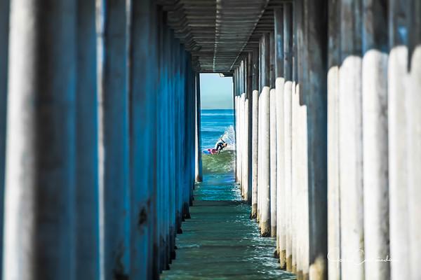 Surfers at Huntington Beach Pier