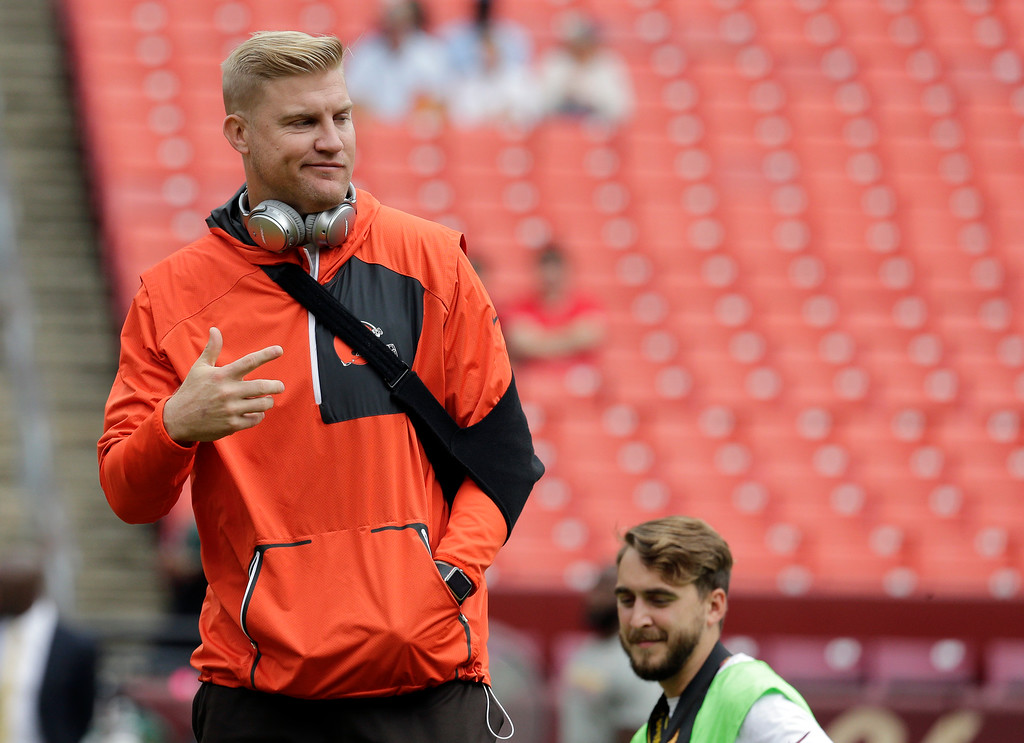 . Injured Cleveland Browns quarterback Josh McCown (13) walks on the field during warm ups before an NFL football game against the Washington Redskins Sunday, Oct. 2, 2016, in Landover, Md. (AP Photo/Chuck Burton)