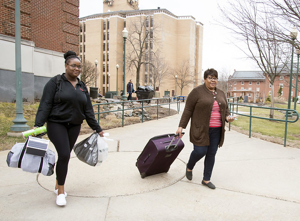 03/12/20 Wesley Bunnell | Staff After being told to leave campus by 5pm tomorrow instead CCSU students were given hours to gather their things and leave the campus by 4 pm Thursday March 12, 2020 as a precaution against the Coronavirus. Haberdale Smith, L, a sophomore walks with her mother Verone Medwinter to their car.