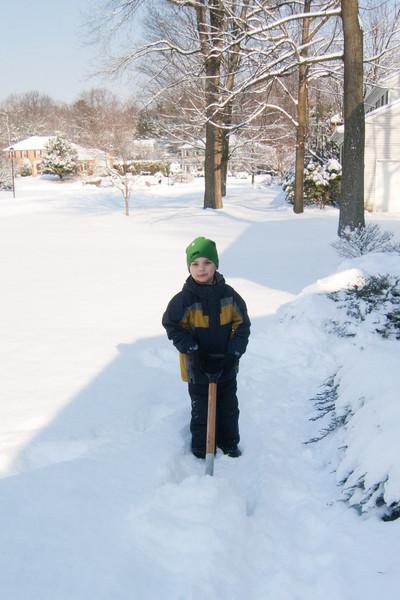 K.C. shovels the walkway.