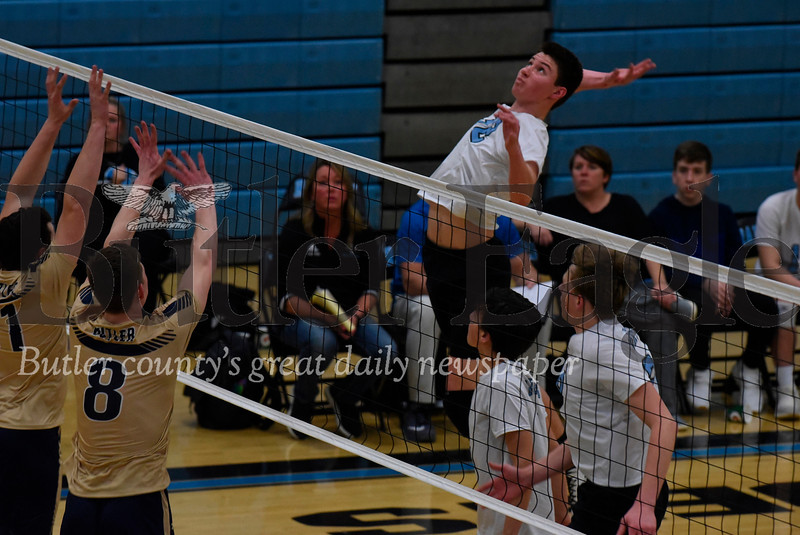 Seneca Valley junior  Ryan Meyer (32) goes for a spike over Nathaniel Sespico(8) and Luke McEachin(11) in Tuesday night's win over Butler.