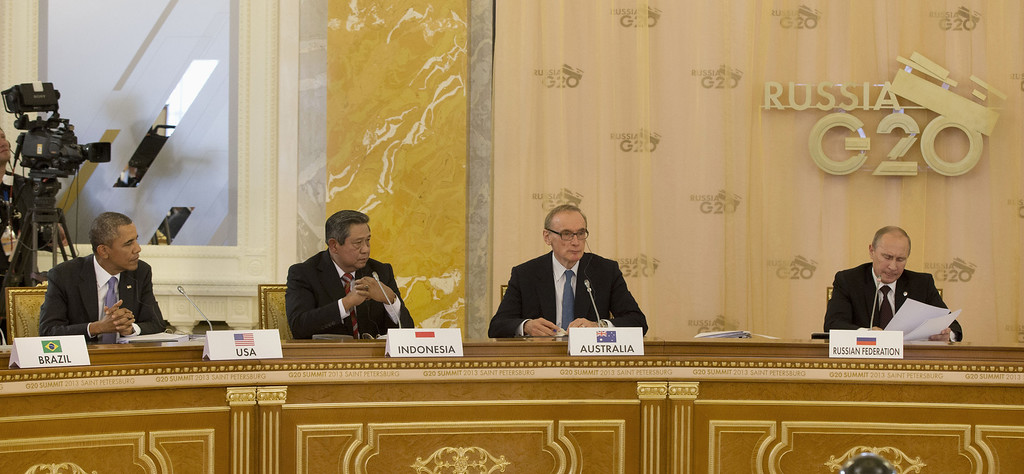 . President Barack Obama, left, listens as Russian President Vladimir Putin, right, speaks during the start of the G-20 Working Session at the Konstantin Palace in St. Petersburg, Russia, Thursday, Sept. 5, 2013. From left are, the president, Indonesian President Susilo Bambang Yudhoyono, Australian Foreign Minister Bob Carr and Putin (AP Photo/Pablo Martinez Monsivais/Pool)