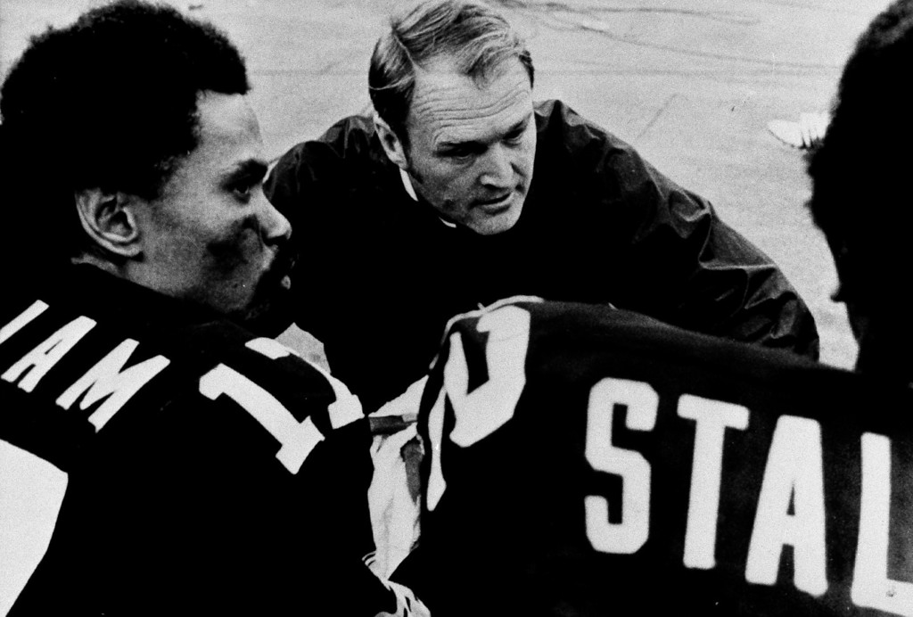 . Steelers coach Chuck Noll confers with quarterback Joe Gilliam, left, and wide receiver John Stallworth during Sunday, Sept. 29, 1975 game to Buffalo. Steelers lost 30-21 to the Buffalo Bills. (AP Photo)