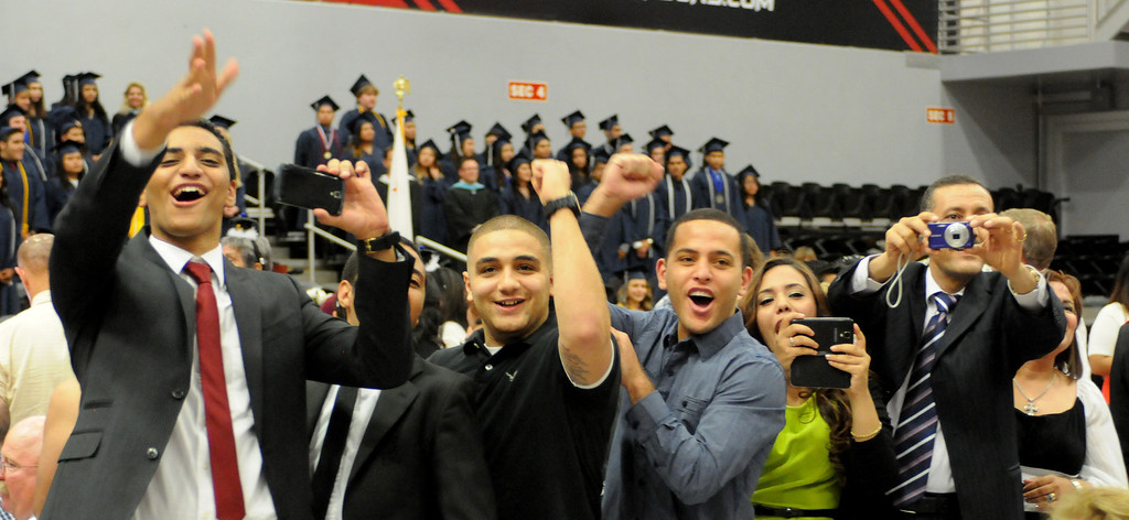 . Excited  family and friends take photographs as the graduates entered the gym during the Northridge Academy High School graduation ceremony on Thursday, June 5, 2014. (Photo by Dean Musgrove/Los Angeles Daily News)