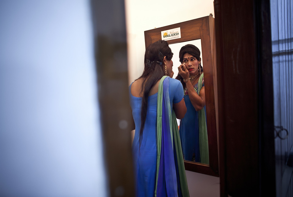 . A Hijra, or transgender, gets ready backstage before the Hijra talent show, part of the first ever event called Hijra Pride 2014, on November 10, 2014 in Dhaka, Bangladesh.  In 2013 Bangladesh officially recognized Hijras as a third gender, though homosexuality still remains illegal. Despite these strides Hijras continue to face violence and harassment as part of their daily life in Bangladesh. (Photo by Allison Joyce/Getty Images)