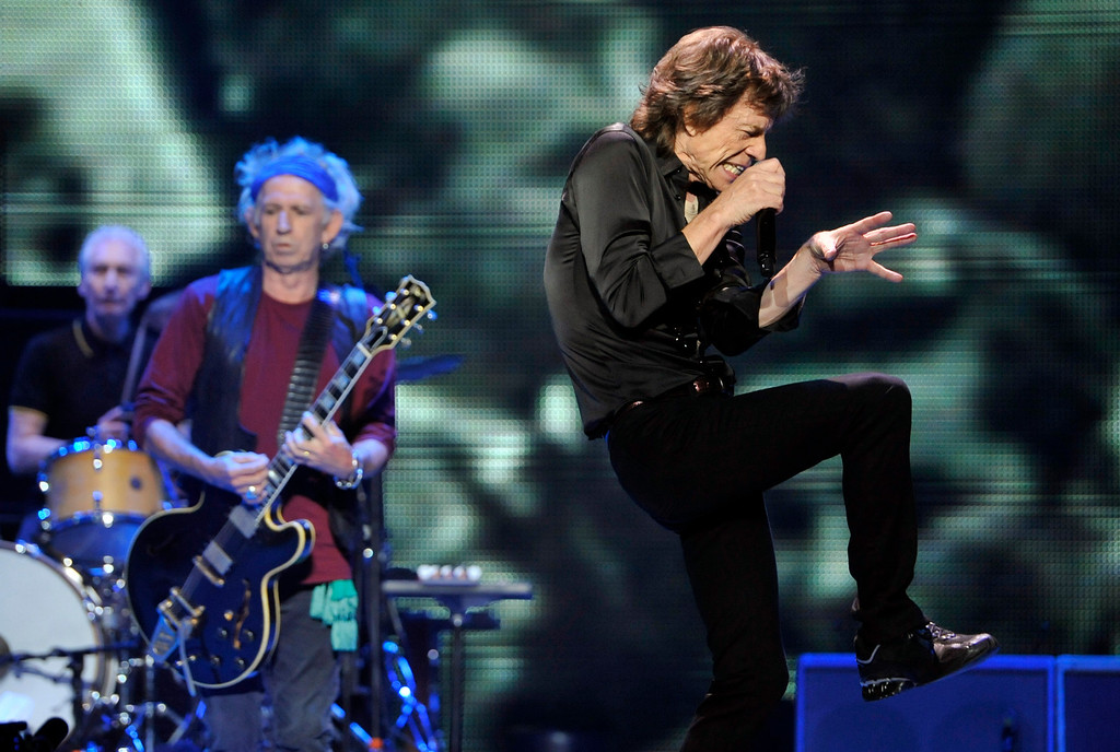 ". Mick Jagger, right, and bandmates Keith Richards, center, and Charlie Watts of the Rolling Stones perform on the kick-off of the band\'s ""50 and Counting\"" tour at the Staples Center on Friday, May 3, 2013 in Los Angeles. (Photo by Chris Pizzello/Invision/AP)"