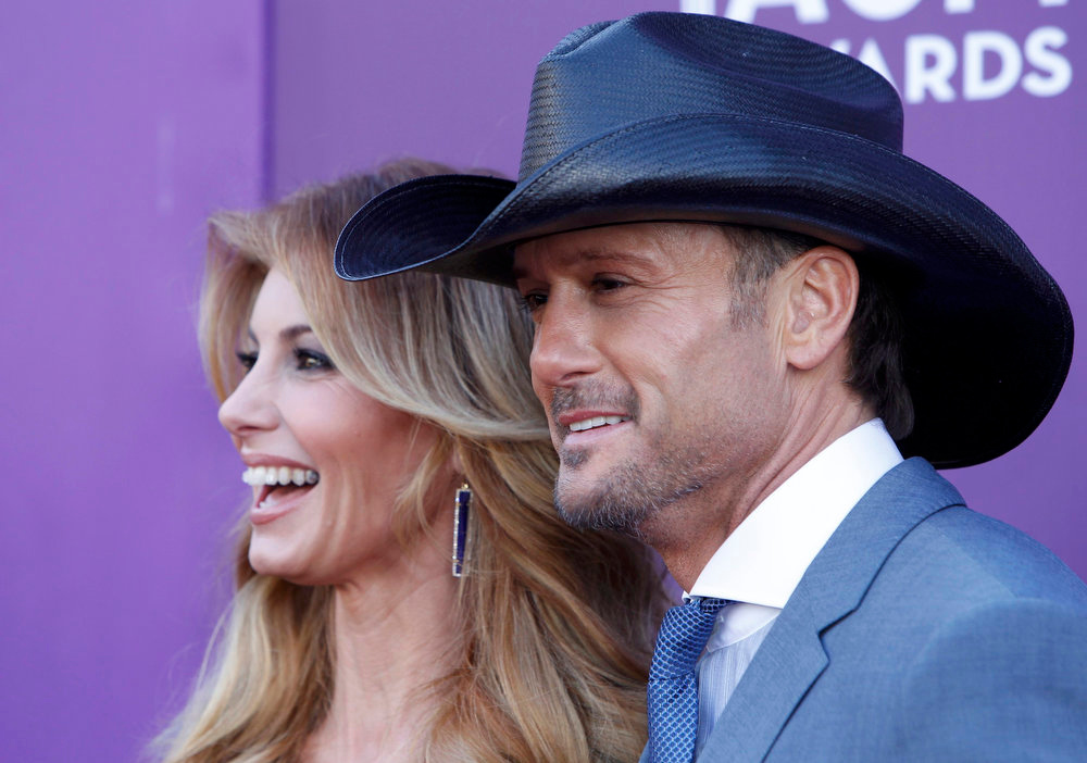 . Singer Faith Hill and her husband Tim McGraw arrive at the 48th ACM Awards in Las Vegas April 7, 2013. REUTERS/Steve Marcus
