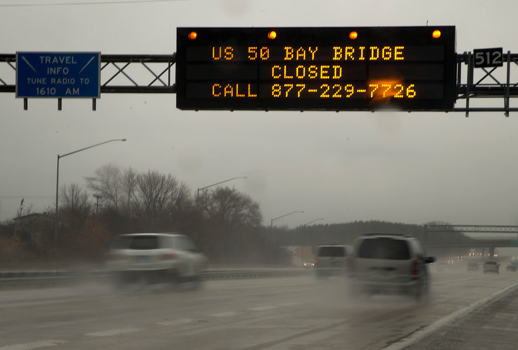 . A sign spanning I 97 South in Millersville, Md., Wednesday, March 6, 2013.,  alerts travelers that the Chesapeake Bay Bridge is closed in both directions.  Maryland\'s Bay Bridge was closed Wednesday afternoon in both directions due to high winds from a snowstorm blowing through the Mid-Atlantic region.  (AP Photo/Carolyn Kaster)