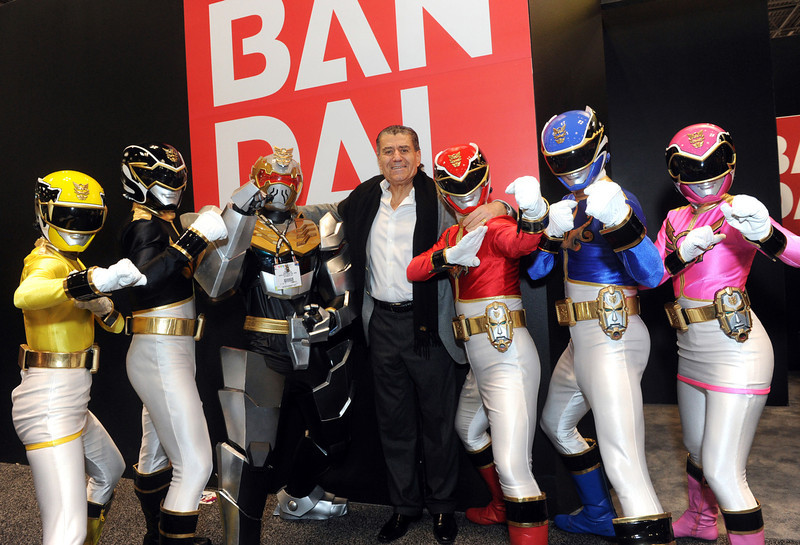. Haim Saban, center, creator of Power Rangers and Chairman and CEO of Saban Capital Group, poses with the Rangers outside the Bandai booth at the American International Toy Fair, Sunday, Feb. 10, 2013, in New York. Saban Brands is celebrating the 20th anniversary of the Power Rangers. (Diane Bondareff/Invision for Saban Brands/AP Images)