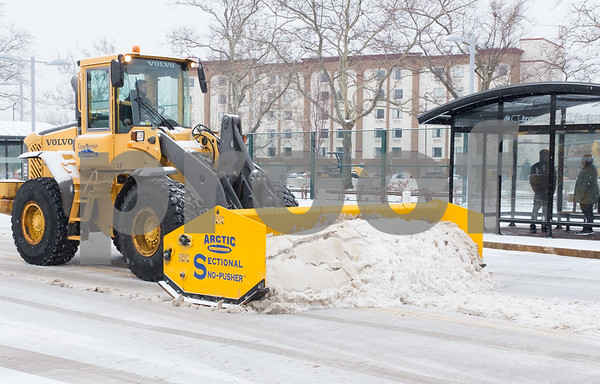 02/07/18 Wesley Bunnell | Staff Snow crews from Cutting Edge Landscaping working Wednesday afternoon to keep the downtown New Britain CTfastrak Station clear from snow.