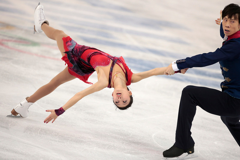 . Pang Qing and Tong Jian of China compete in the pairs free skate figure skating competition at the Iceberg Skating Palace during the 2014 Winter Olympics, Wednesday, Feb. 12, 2014, in Sochi, Russia. (AP Photo/Ivan Sekretarev)