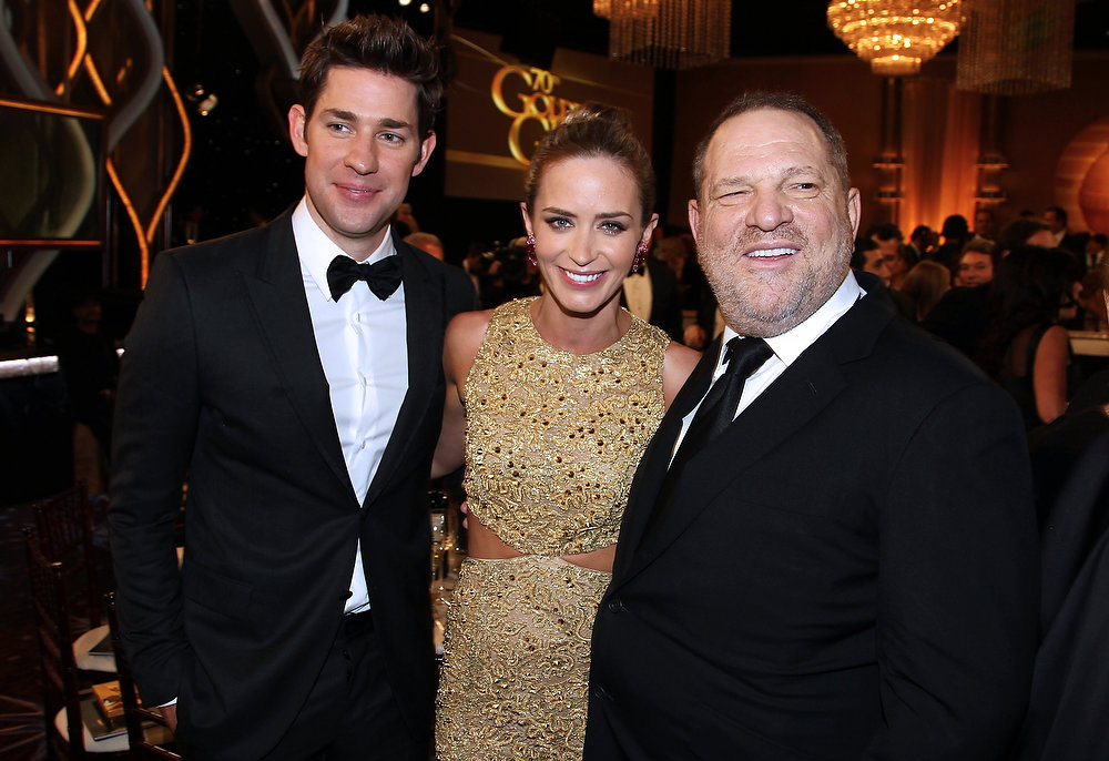 Description of . Actors, from left, John Krasinski, Emily Blunt and producer Harvey Weinstein pose at the 70th Annual Golden Globe Awards at the Beverly Hilton Hotel on Sunday Jan. 13, 2013, in Beverly Hills, Calif. (Photo by Matt Sayles/Invision/AP)