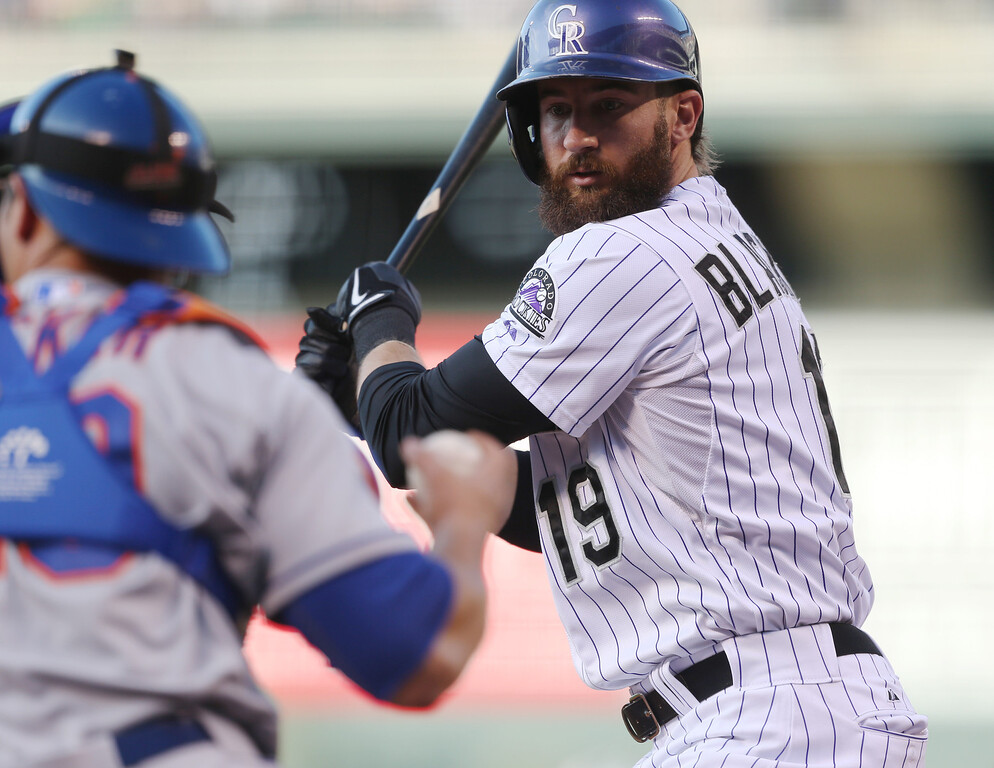 . Colorado Rockies\' Charlie Blackmon, right, reacts after striking out while swinging at a pitch as New York Mets catcher Anthony Recker puts the ball back into play in the first inning of a baseball game in Denver, Saturday, May 3, 2014. (AP Photo/David Zalubowski)