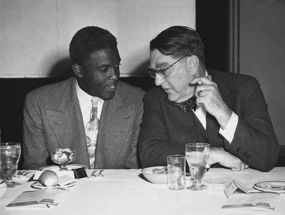 Description of . Brooklyn Dodgers\' president Branch Rickey, right, and  star Jackie Robinson confer at the Chicago Baseball Writers\' Association annual dinner in Chicago, Ill., in this Jan. 18, 1948 file photo. (AP Photo)