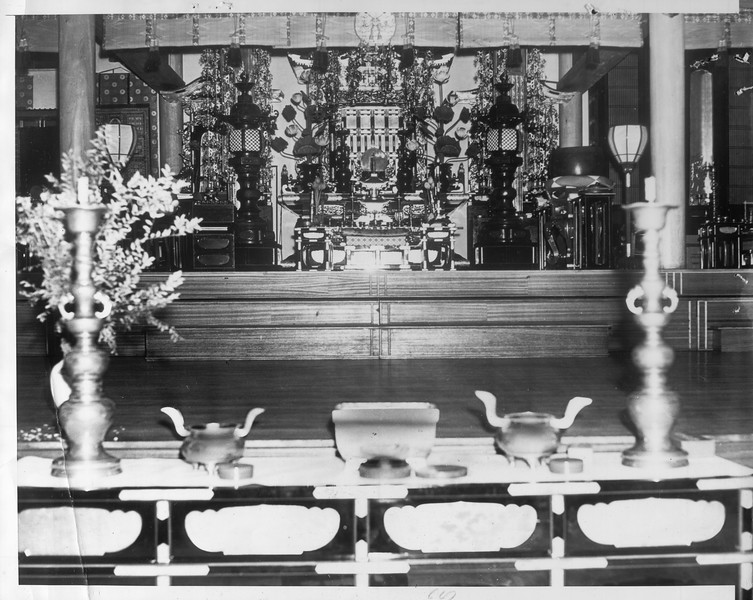 """""""Empty today is the Koyasan Beikoku Betsuin Buddhist Temple, hidden in an alley off First street.  Its altar, shipped from Japan, is work thousands of dollars.""""--caption on photograph"""