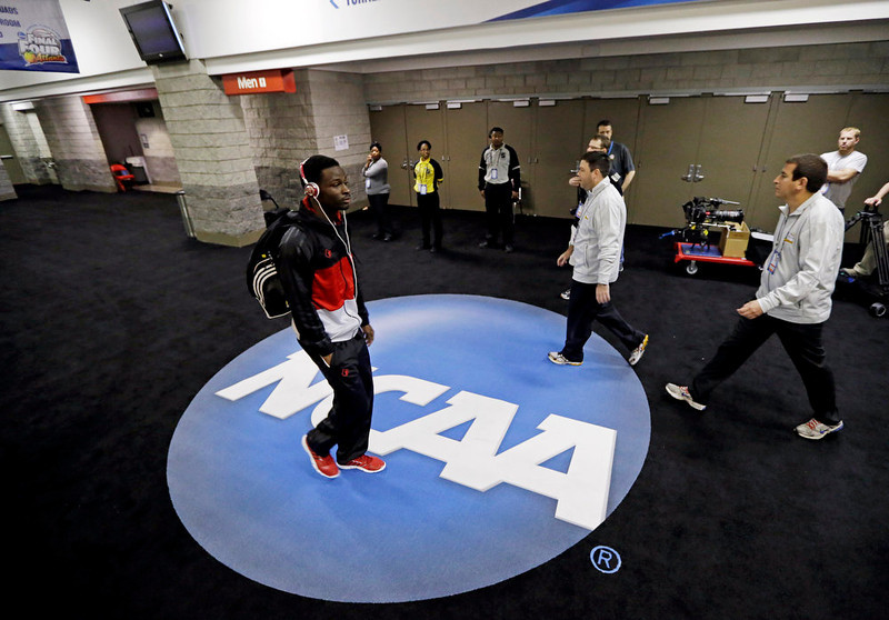 . Louisville\'s Michael Baffour makes his way to the locker room before a practice for their NCAA Final Four tournament college basketball game Sunday, April 7, 2013, in Atlanta. Louisville plays Michigan in the championship game on Monday. (AP Photo/Charlie Neibergall)