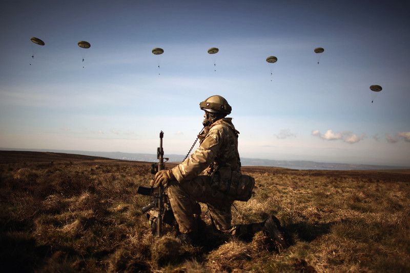 . A soldier from 16 Air Assault Brigade take part in Exercise Joint Warrior at West Freugh Airfield on April 16, 2012 in Starnraer, Scotland. The operation is taking place in South West Scotland between 15-21 April and focuses on a Theatre Entry operation into a notional country. The exercise will involve more than 1600 troops, and be supported by Apache, Chinook, and Royal Navy Sea King Helicopters from the Joint Helicopter Force. RAF Fast Jets and support aircraft, as well as several US and French aircraft will also support the exercise. This year the ABTF will be joined by a number of French personnel from 11 Parachute Brigade.  (Photo by Jeff J Mitchell/Getty Images)