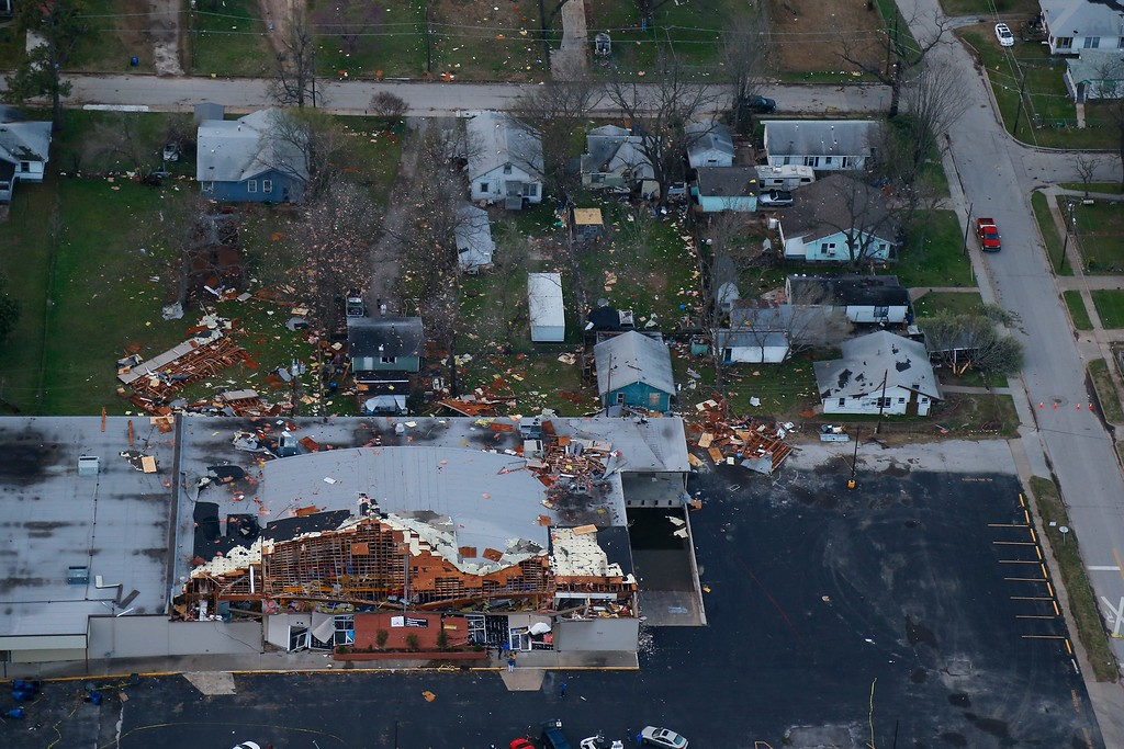 . This aerial photo shows storm damage of the The Aim High Academy building, where the roof collapsed on Thursday, March 26, 2015 in Sand Springs, Okla.  The first batch of severe weather in this year\'s tornado season devastated parts of Oklahoma, as storms across the area damaged buildings, tore off roofs and left debris strewn across roads.  (AP Photo/Tulsa World,  Tom Gilbert)